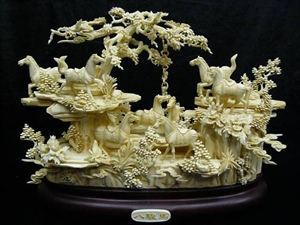 Picture of ANTIQUE BONE SADDLED TANG HORSES MOUNTAIN (02S2)